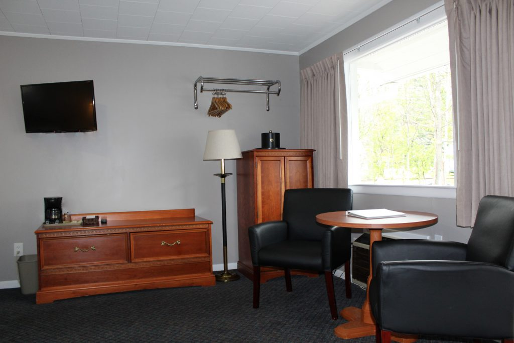 tables and chairs in motel room