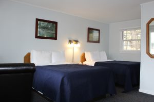 Motel Room with 2 double Beds with blue bedspreads