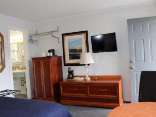 Motel Room with wood furnishings